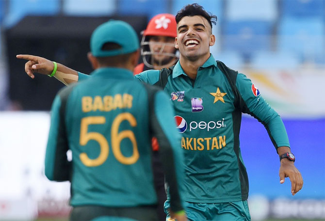 Pakistan's Shadab Khan celebrates a wicket against Hong Kong during their Asia Cup match in Dubai on Sunday