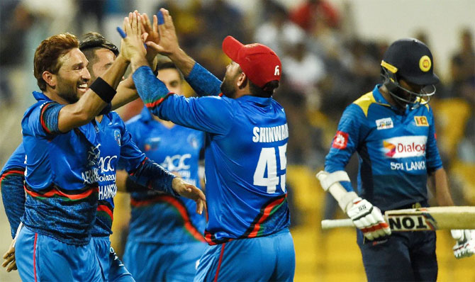 Afghanistan players celebrate the fall of a Sri Lankan wicket