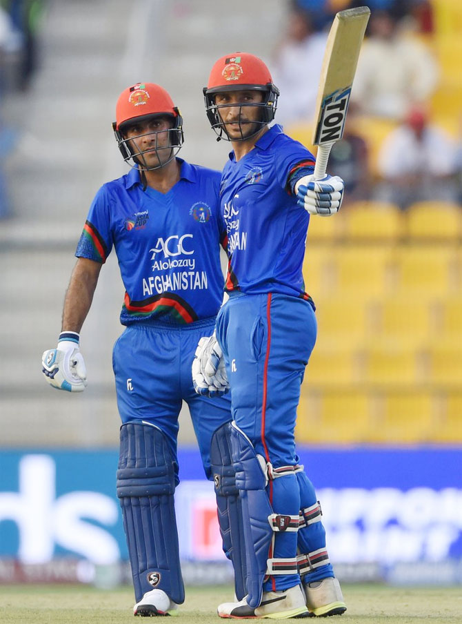 Afghanistan's Rahmat Shah celebrates on completing his half-century