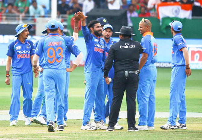 Ravindra Jadeja is congratulated by teammates after claiming a Bangladesh wicket
