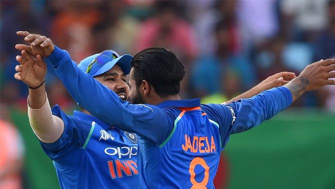 India captain Rohit Sharma and Ravindra Jadeja celebrate on claiming a wicket