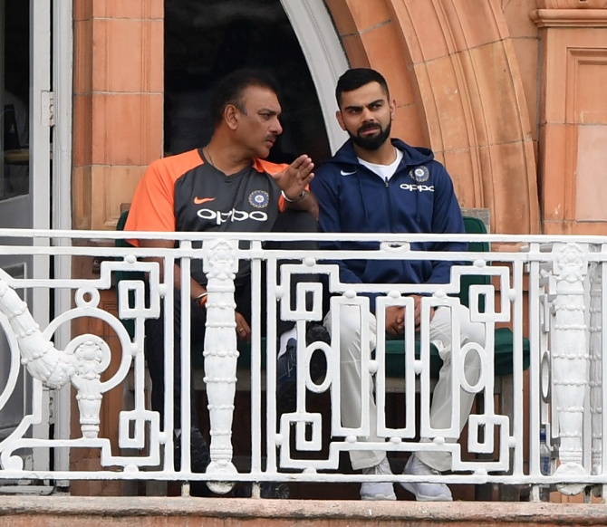 Virat Kohli with coach Ravi Shastri