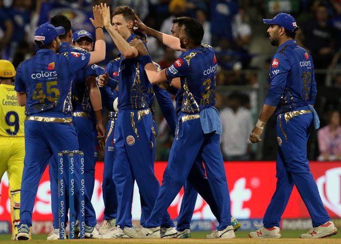 Mumbai Indians players celebrate after Jason Behrendorff dismissed Ambati Rayudu