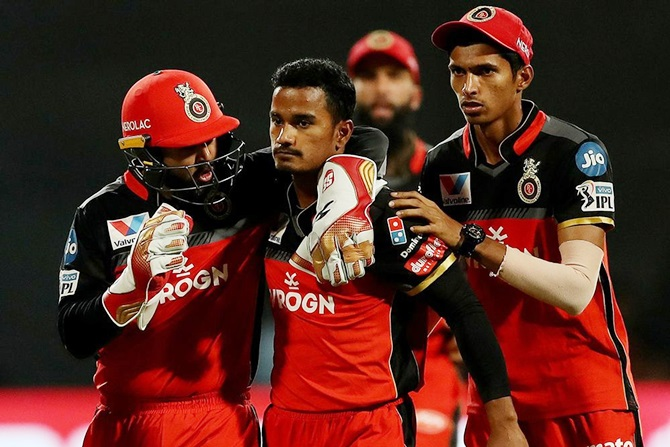 Pawan Negi is congratulated by his RCB teammates