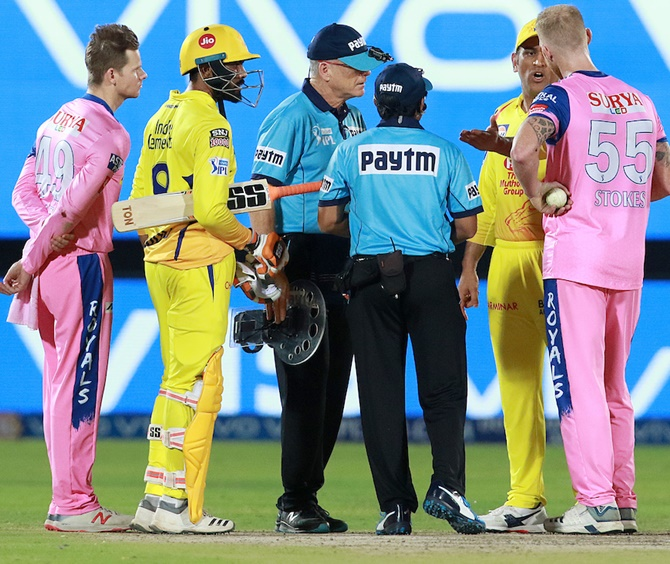 Chennai Super Kings captain Mahendra Singh Dhoni speaks to the umpires and Rajasthan Royals pacer Ben Stokes. Dhoni entered the field of play for an angry confrontation with umpire Ulhas Gandhe, who backtracked after signalling a no ball after Rajasthan pacer Ben Stokes bowled a high-full toss to Mitchell Santner during an IPL match on Thursday, April 11