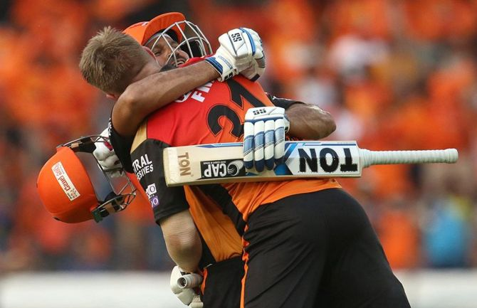 Yusuf Pathan of Sunrisers Hyderabad hugs David Warner after his century during a match in IPL-12.