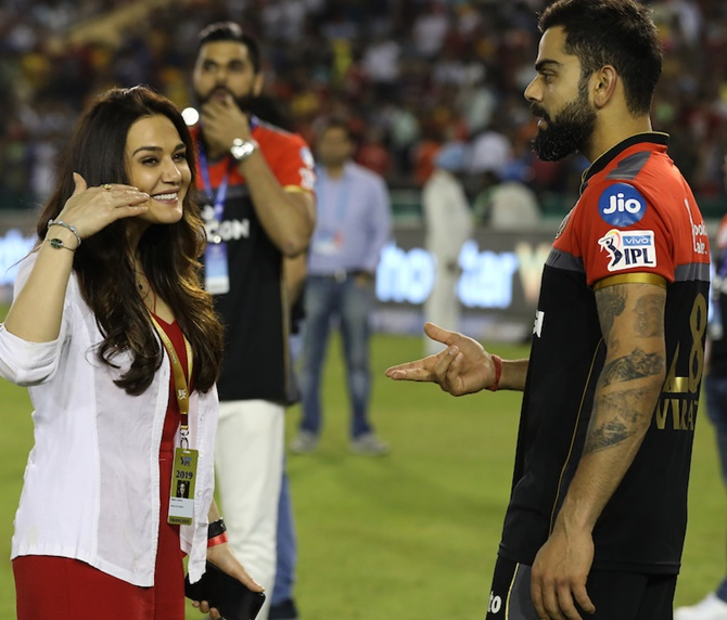 Royal Challengers Bangalore captain Virat Kohli meets Kings XI Punjab owner Preity Zinta after the Indian Premier League match in Mohali on Saturday, April 13