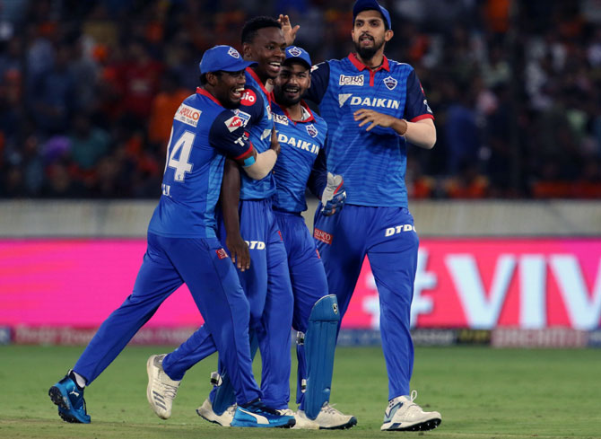 Delhi Capitals' players celebrate a wicket