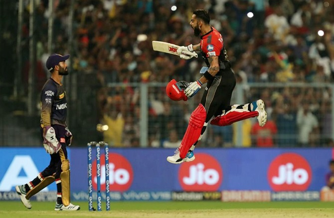 Royal Challengers Bangalore's Virat Kohli launches into a celebratory run after completing his hundred during Friday's IPL match against Kolkata Knight Riders, in Kolkata on April 19
