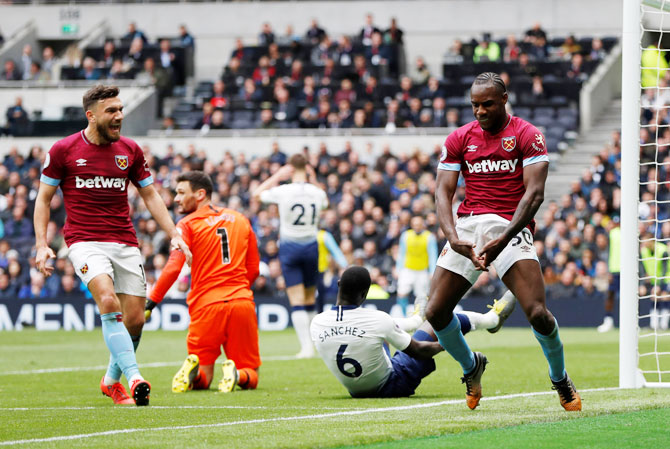 West Ham's Michail Antonio (right) celebrates scoring their first goal against Tottenham Hotspur at Tottenham Hotspur Stadium, London, on Saturday