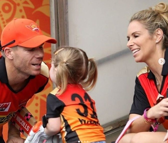 David Warner with daughter Ivy Mae and wife Candice