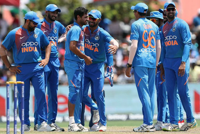 India's players celebrate the dismissal of Evin Lewis