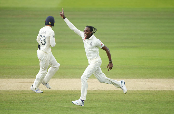 England's Jofra Archer celebrates after taking the wicket of Australia's Usman Khawaja