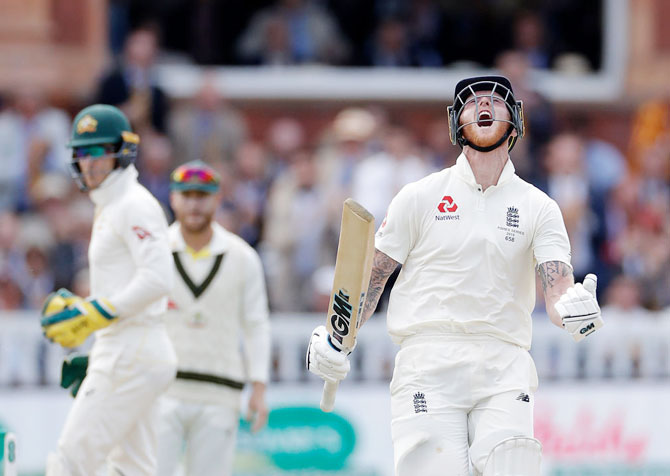 England's Ben Stokes celebrates after reaching his century on Day 5 of the 2nd Ashes Test between against Australia at Lord's Cricket Ground in London on Sunday
