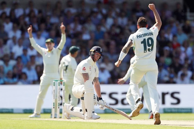 England's Ben Stokes reacts after losing his wicket even as Australia's James Pattinson celebrates.