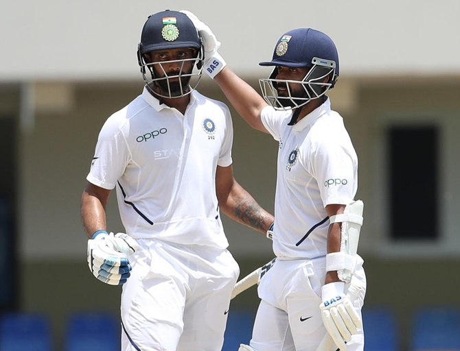 Hanuma Vihari is congratulated by Ajinkya Vihari after completing his fifty