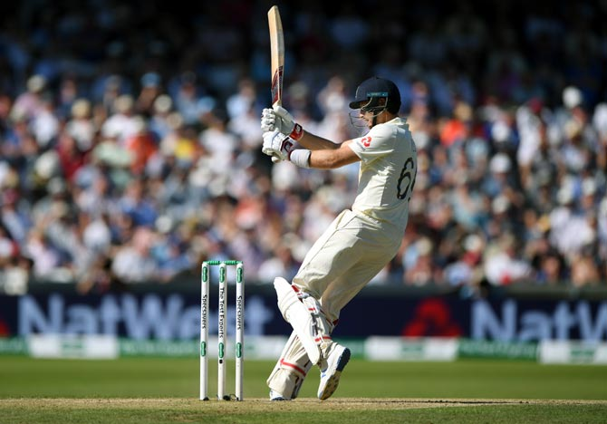 PHOTOS: Captain Root keeps England's hopes alive