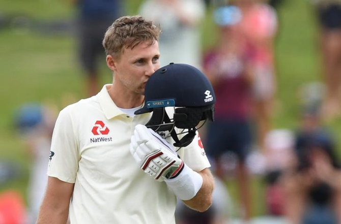 England's Joe Root celebrates his century during Day 3 of the second Test against New Zealand