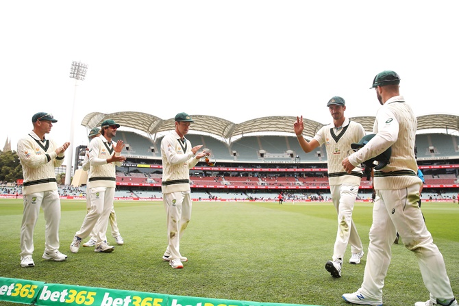 Australia pacer Mitchell Starc is applauded as he leaves the field after taking six wickets in the Pakistan first innings on Sunday, Day 3 of the second Test, at the Adelaide Oval.