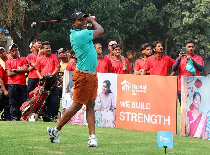 Former West Indies batting great Brian Lara plays golf at a promotional event in Mumbai on Friday