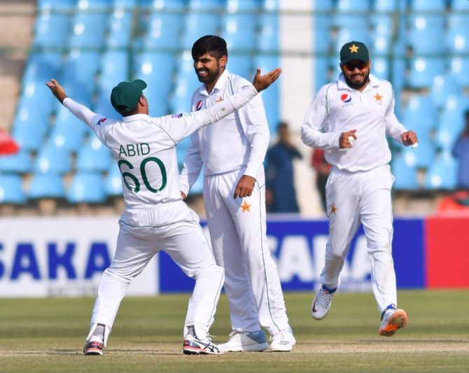 Pakistan's Haris Sohai celebrates with teammates after taking out Sri Lanka's Niroshan Dickwella during the 2nd Test in Karachi on Sunday