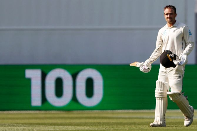 New Zealand's Tom Blundell raises his bat after scoring his century