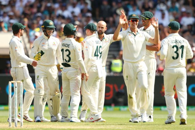 Australian players celebrate with Nathan Lyon after the dismissal of New Zealand's Colin de Grandhomme