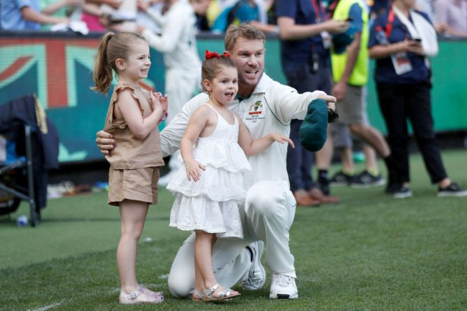 Australia's David Warner celebrates with his daughters Ivy Mae and Indi Rae walk after victory on Day 4