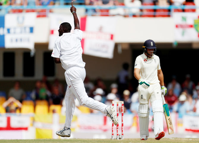 West Indies' Jason Holder celebrates the wicket of England's Jos Buttler on Day 1 of the 2nd Test at Sir Vivian Richards Stadium, North Sound, Antigua and Barbuda on Thursday