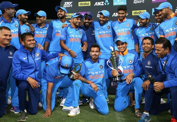 The India squad celebrate the ODI series win in New Zealand. Photograph: Hagen Hopkins/Getty Images