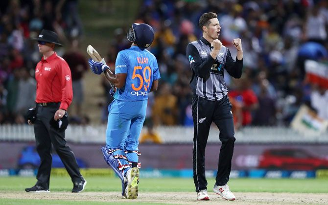 Mitchell Santner celebrates the wicket of Vijay Shankar