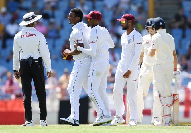 West Indies bowler Shannon Gabriel (left) is ushered away by teammate Kraigg Brathwaite after confronting England's Joe Root and Joe Denly on Day 3 of the 3rd Test at Darren Sammy Cricket Ground in Gros Islet, Saint Lucia, on Tuesday. Root, who finished the day on 111 not out, refused to divulge what Gabriel said when asked about the incident at the end of day's play, saying it should stay on the field