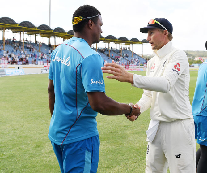England captain Joe Root shakes hands with West Indies' Shannon Gabriel following England's Victory during day 4 of the 3rd Test at Darren Sammy Cricket Ground in Gros Islet, Saint Lucia, on Tuesday