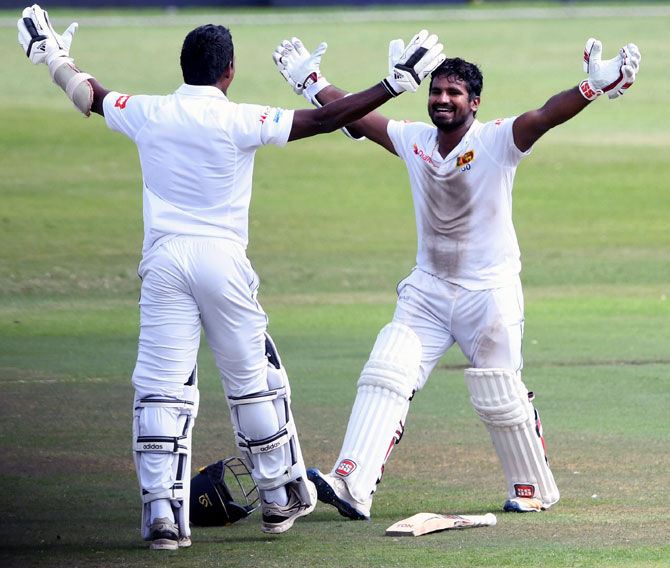 Kusal Perera, right, and Vishwa Fernando celebrate Sri Lanka's one-wicket victory in the first Test against South Africa at Kingsmead stadium on Saturday