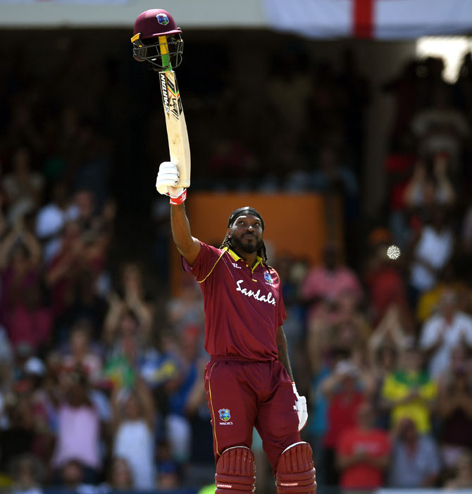 West Indies' Chris Gayle celebrates in style after reaching his century against England in their opening One-Day International in Barbados on Wednesday, February 20