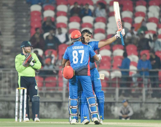 Afghanistan's Hazratullah Zazai celebrates on scoring a century. He scored the second fastest T20I century against Ireland to a record Twenty20 international total of 278-3 in Dehradun on Saturday.  The strongly-built opening batsman smashed an unbeaten 162 off 62 deliveries. Hazratullah's unbeaten 162 was the highest score by an Asian batsman in T20 Internationals