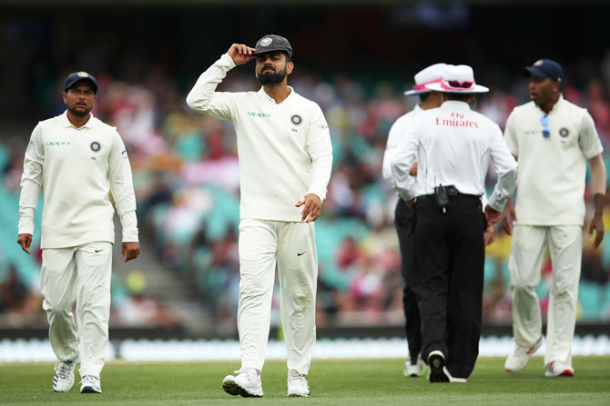 India captain Virat Kohli reacts after umpires take early tea due to bad light.