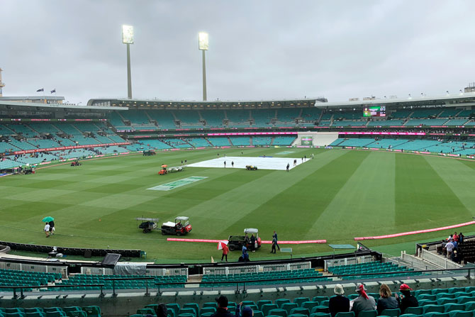 The pitch is kept under covers with the start of play delayed on Day 4 due to rain and poor light
