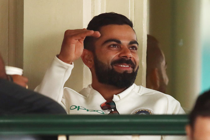 India captain Virat Kohli has a light moment in the dressing room on Day 4 of the 4th Test at the SCG in Sydney on Sunday