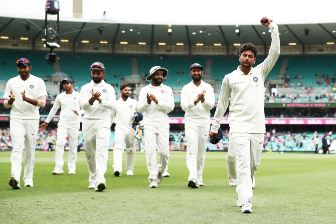 Kuldeep Yadav leads the Indian team out of the field after his five-wicket haul against Australia on Day 4
