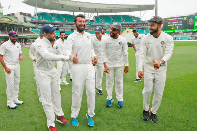 Cheteshwar Pujara is egged on to shake a leg as the Indian team celebrates