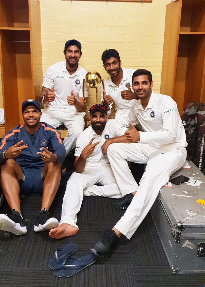 Indias's bowlers celebrate in the dressing room