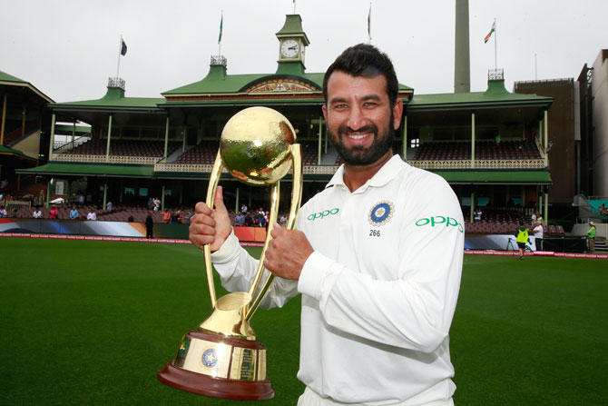 Man of the series, Cheteshwar Pujara celebrates with the trophy