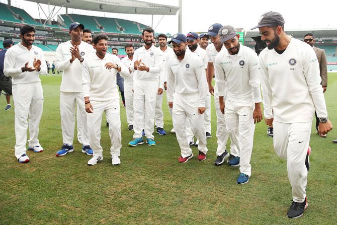 India's Virat Kohli, Ajinkya Rahane and Rishabh Pant break into a jig in celebration