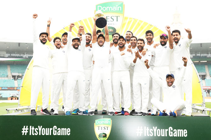 India players celebrate with the trophy after winning the four-match Test series 2-1 at the Sydney Cricket Ground on Monday