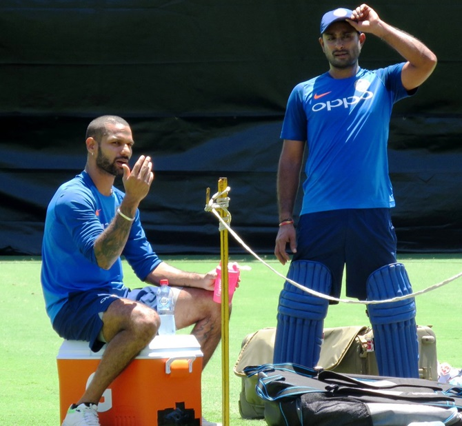 Shikhar Dhawan and Ambati Rayudu chat during a training session in Sydney