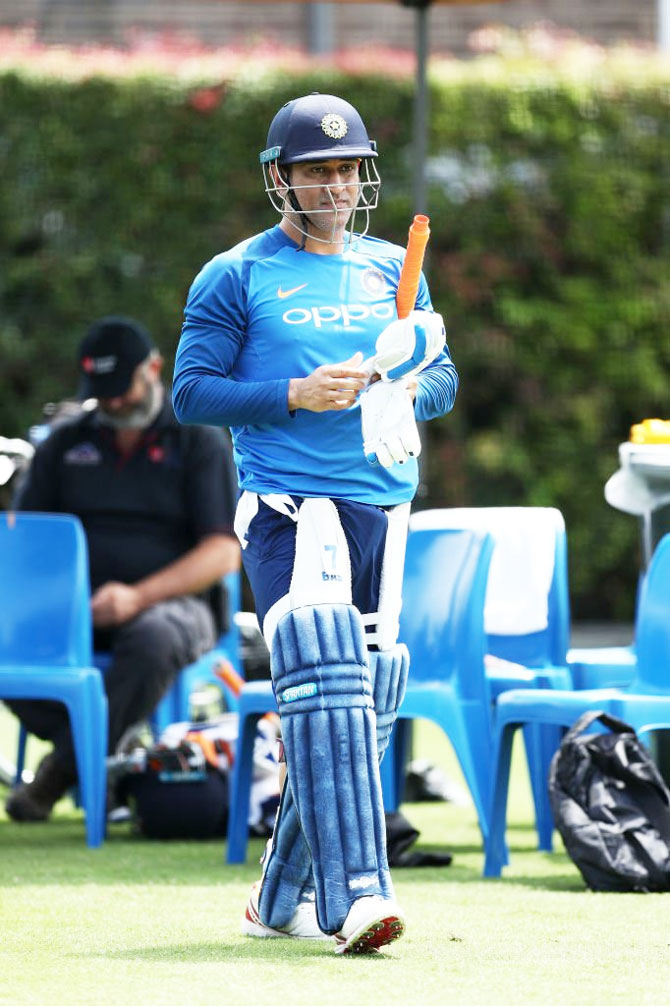 Mahendra Singh Dhoni readies for the nets session at the SCG on Friday