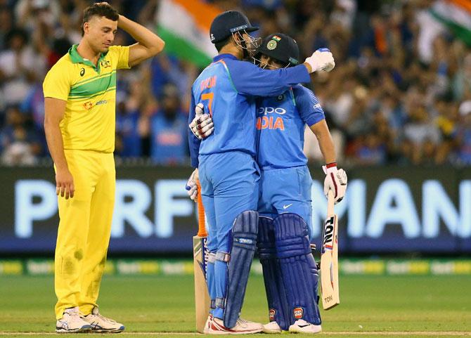 Mahendra Singh Dhoni and Kedar Jadhav celebrate winning the third and final ODI in Melbourne
