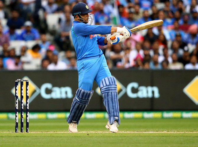 Mahendra Singh Dhoni hits a boundary during his innings of 87 not out in the final game of the One Day International series between Australia and India at Melbourne, January 18, 2019. Photograph: Mike Owen/Getty Images