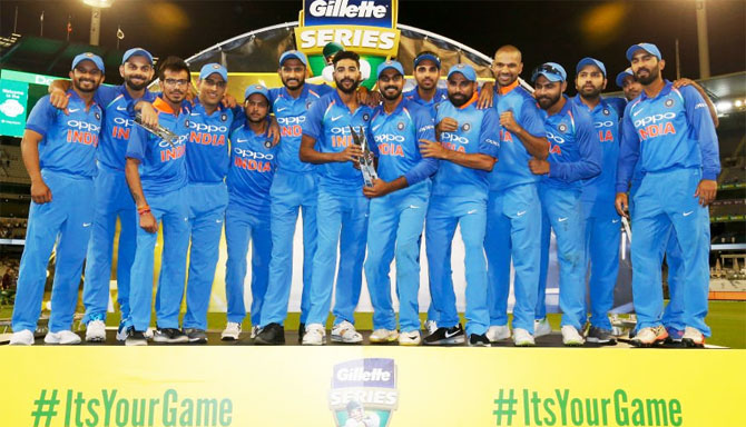 Team India celebrate with the trophy after winning the ODI series 2-1 in Melbourne on Friday
